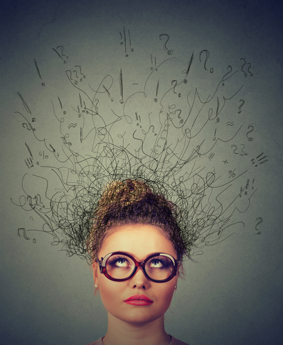 Closeup portrait young woman wondering, thinking daydreaming with brain melting into lines question marks looking up isolated on gray background. Human facial expressions, emotion feeling sign
